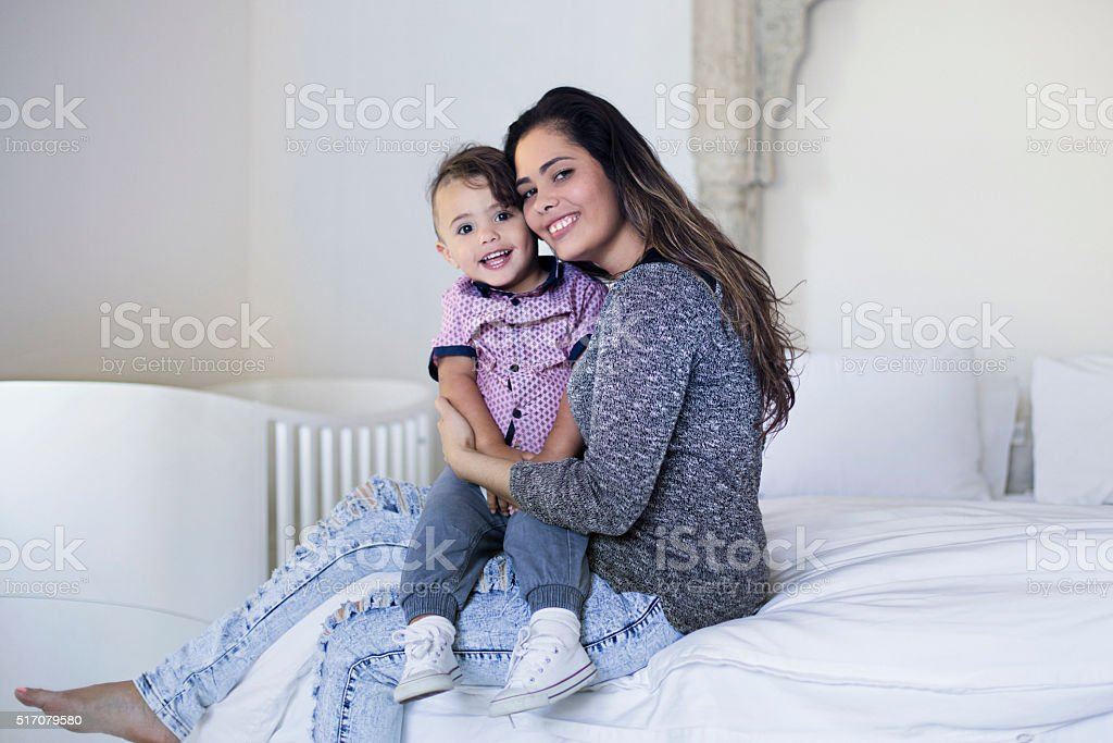 Portrait of Aboriginal mother and son in the bedroom stock photo