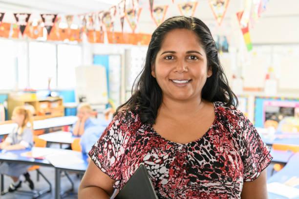 Portrait of Aboriginal woman in school classroom stock photo