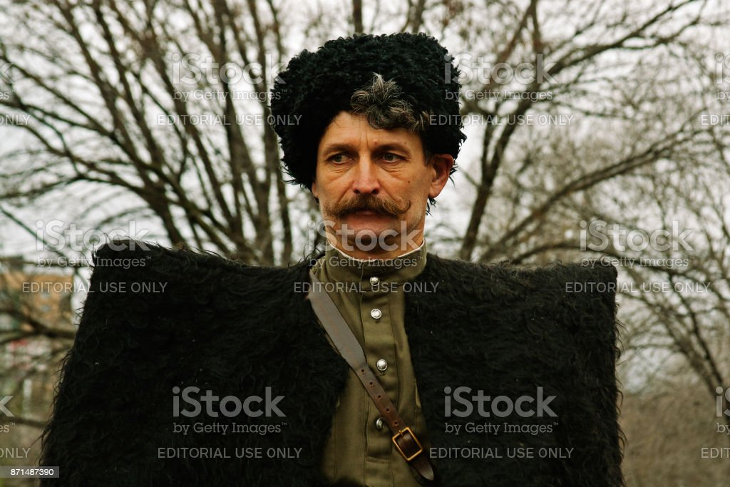 Portrait of actor dressed as cossack of World War II in military-historical reconstruction in stock photo