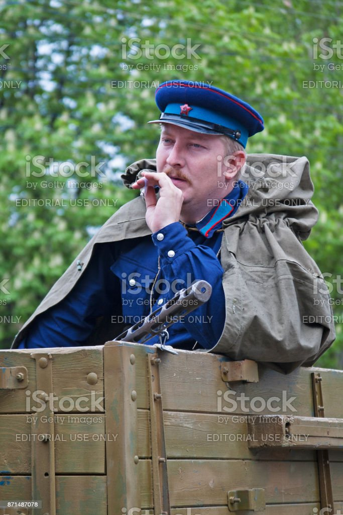 Portrait of actor dressed as Russian Soviet soldier of World War II on Victory Day celebration in Volgograd stock photo