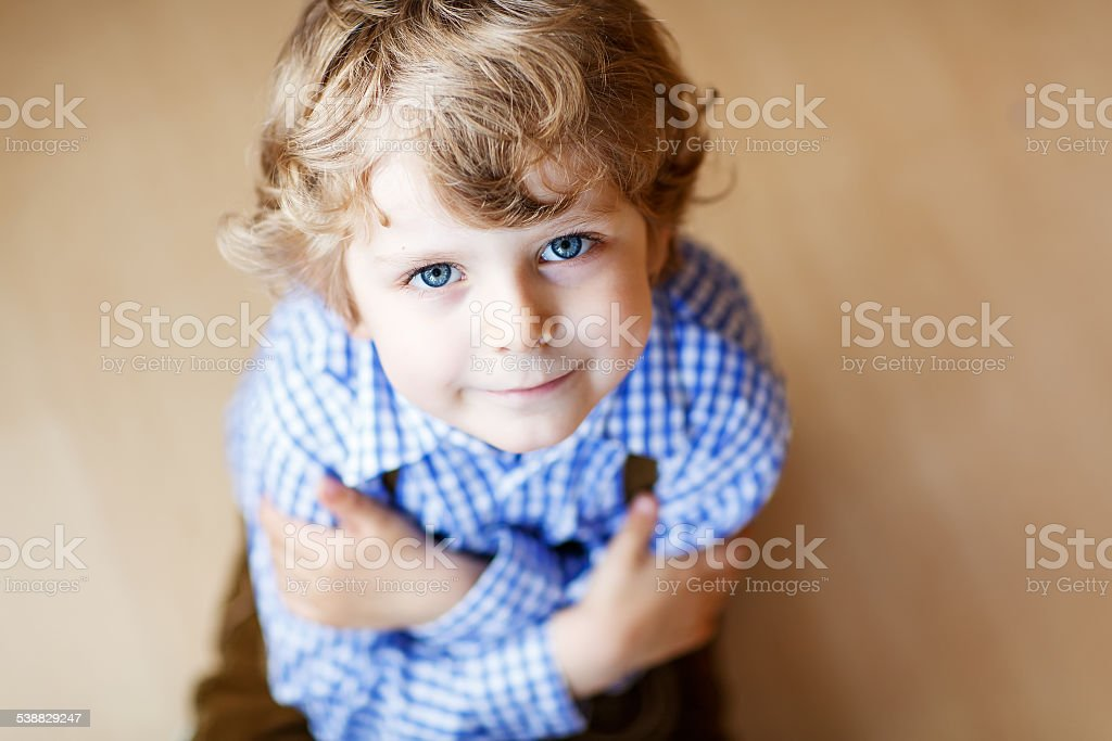 Portrait of adorable little boy with blue eyes stock photo
