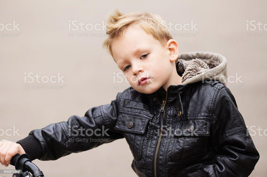 portrait of adorable little urban boy wearing black leather jack zbiór zdjęć royalty-free