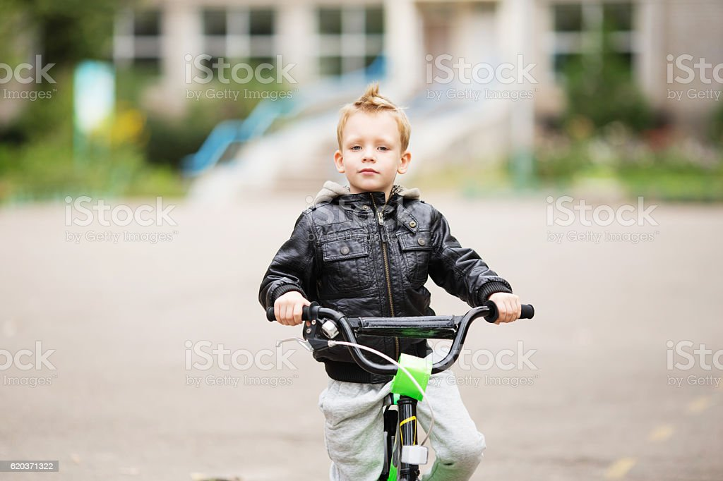 portrait of adorable little urban boy wearing black leather jack foto de stock royalty-free
