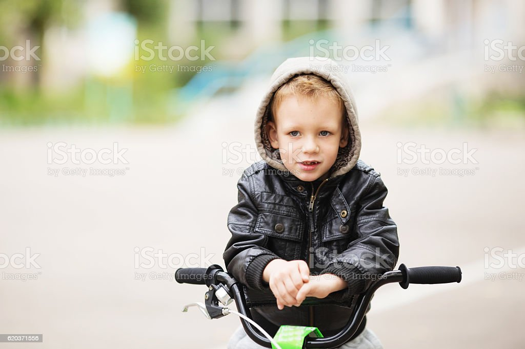 portrait of adorable little urban boy wearing black leather jack zbiór zdjęć royalty-free