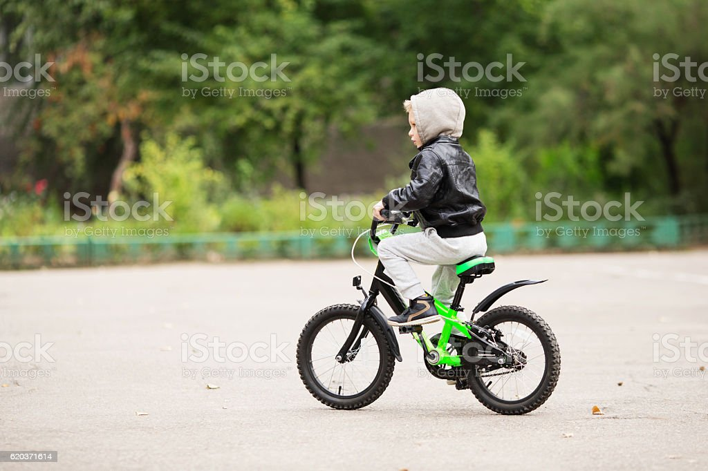 portrait of adorable little urban boy wearing black leather jack foto de stock royalty-free