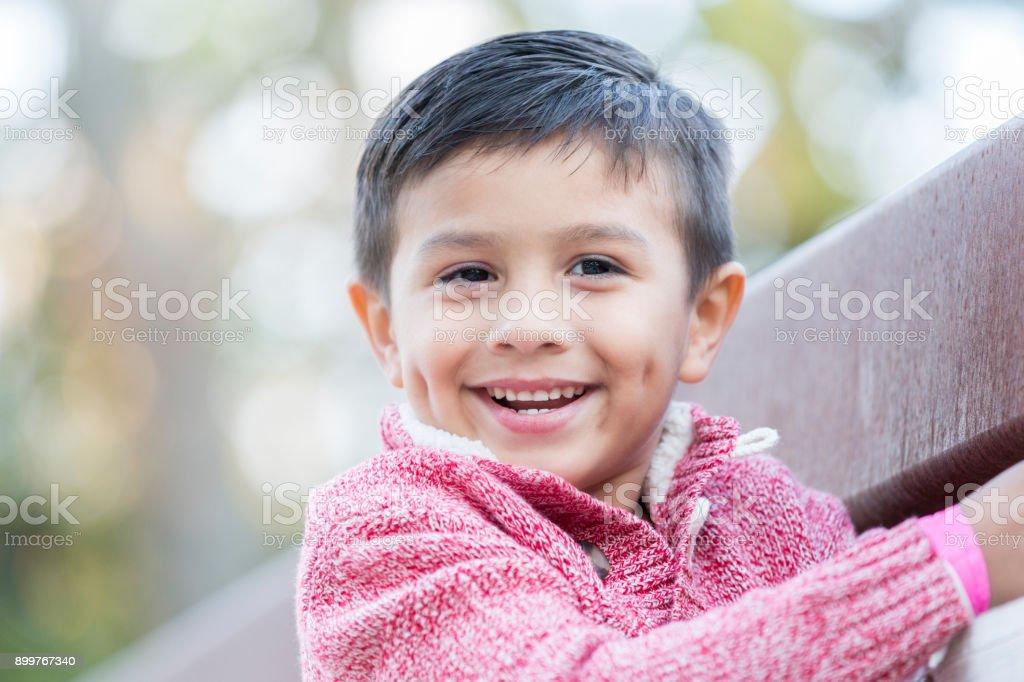 Portrait of adorable mixed race boy stock photo