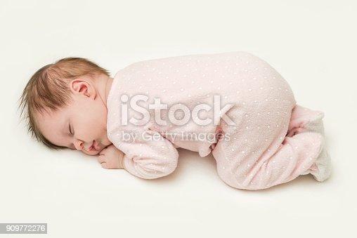 istock Portrait of adorable newborn baby girl sleeping 909772276