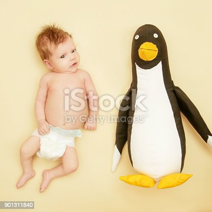 875685464 istock photo Portrait of adorable newborn baby with her penguin friend 901311840