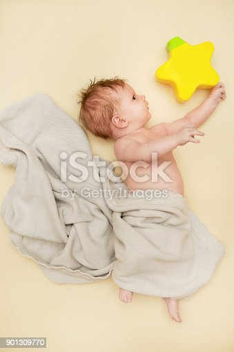 875685464 istock photo Portrait of adorable newborn baby with star shaped toy 901309770