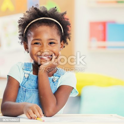 istock Portrait of adorable preschooler in her classroom 909258602