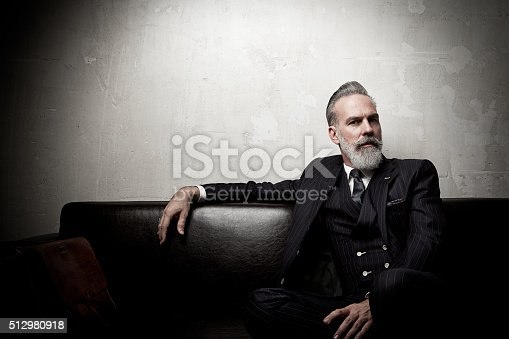 istock Portrait of adult businessman wearing trendy suit and sitting modern 512980918