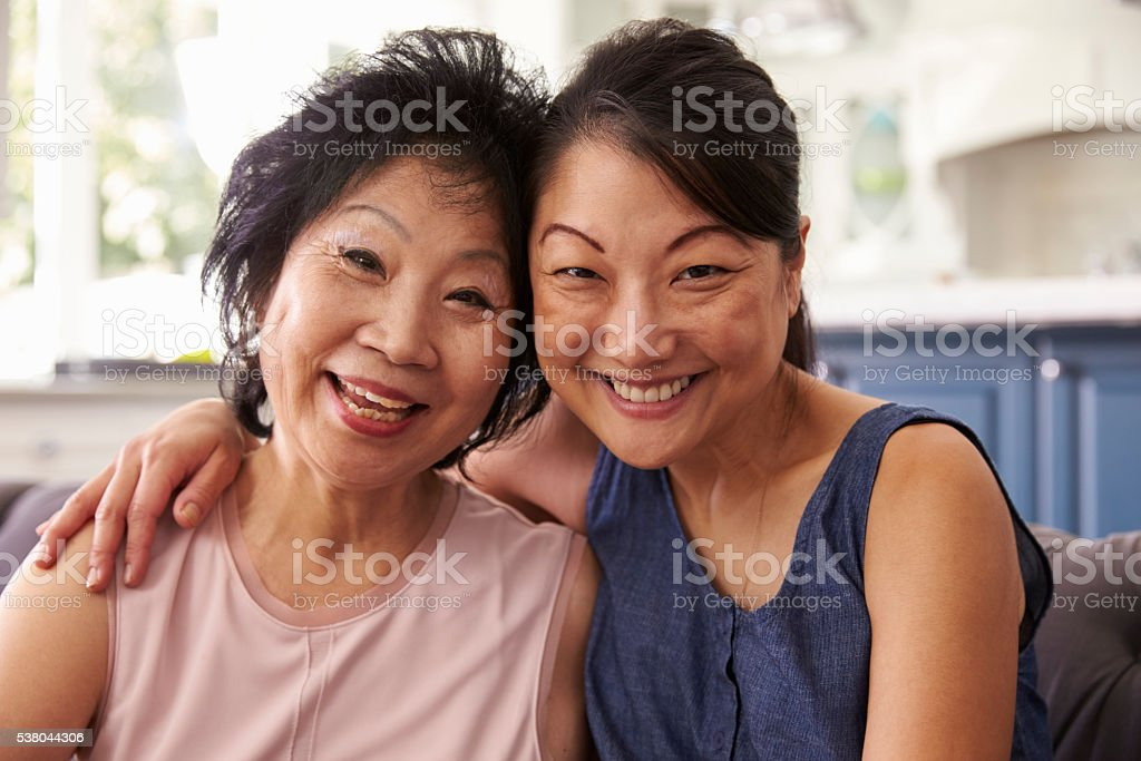 Portrait Of Adult Daughter Talking To Mother At Home stock photo