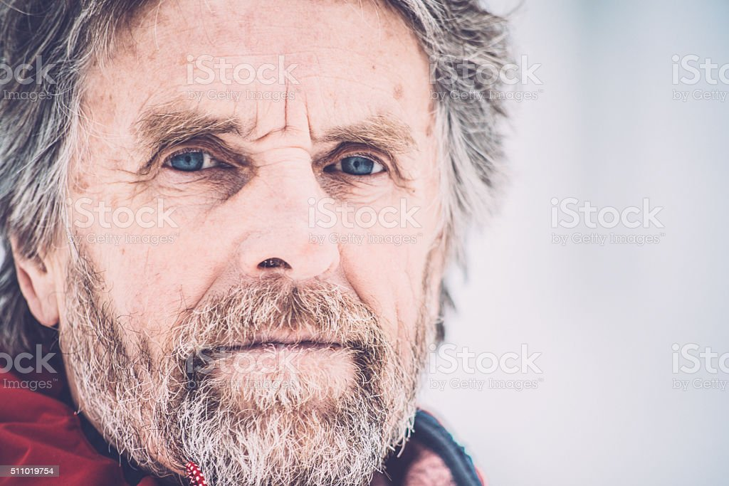 Portrait of Adventurous Senior Man Hiking in Forest, Snowing, Europe stock photo