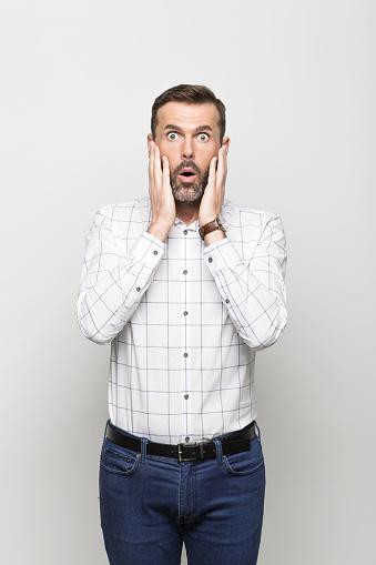 Portrait Of Afraid Businessman Grey Background Stock Photo - Download Image Now