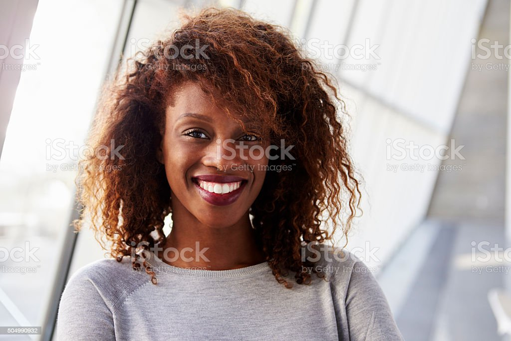 Portrait Of African American Businesswoman In Modern Office stock photo