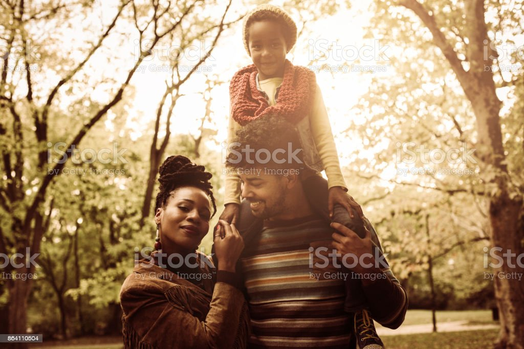 Portrait of African American family in park together. royalty-free stock photo