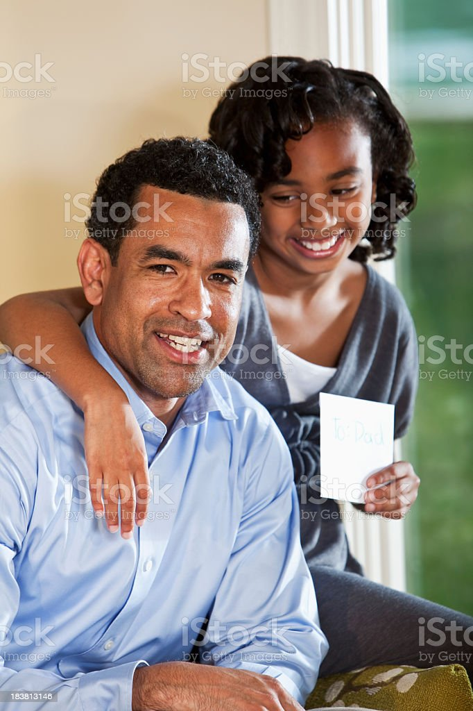 Portrait of African American father and daughter stock photo