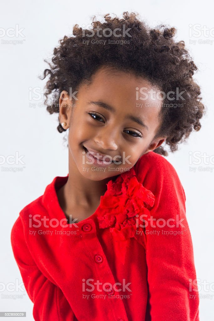 Portrait Of African American Preschool Girl With Curly Hair