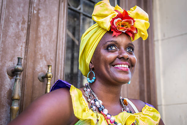 portrait of african cuban woman looking at camera smiling - caribbean culture stock pictures, royalty-free photos & images
