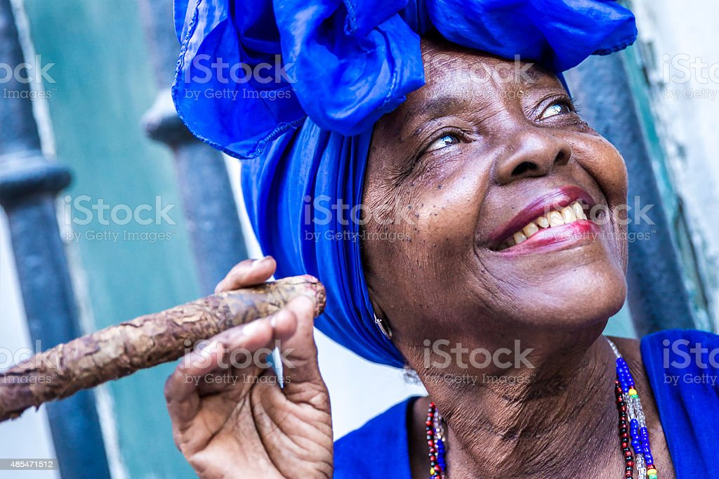 Portrait of african cuban woman smoking cigar in Havana, Cuba stock photo