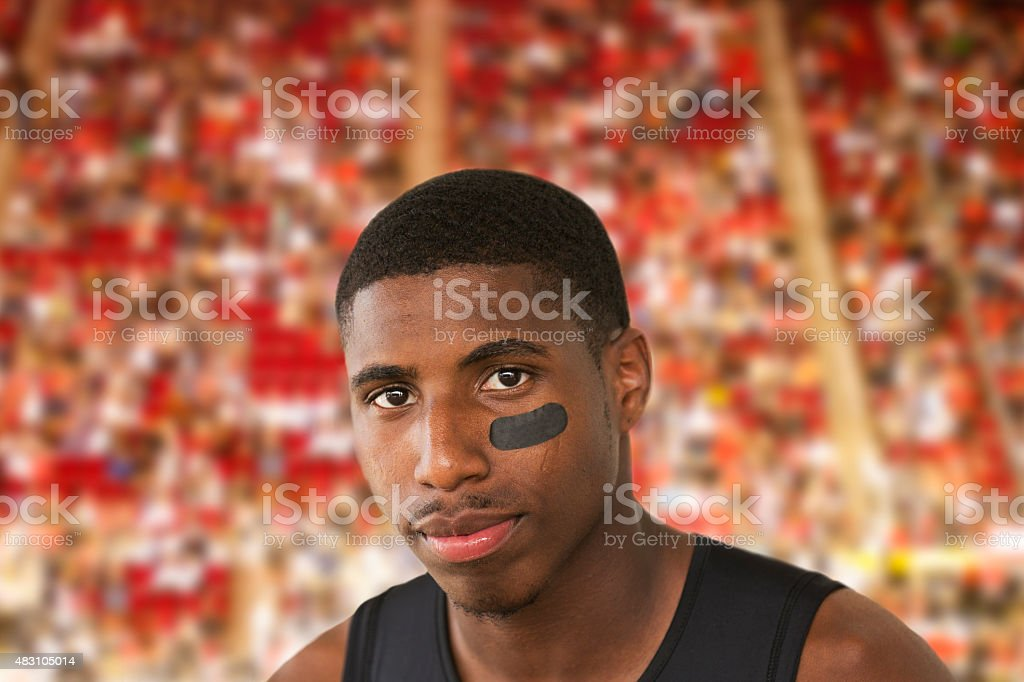 Portrait of African descent, American football player waiting at stadium. stock photo