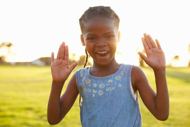 Best Waving Hello Stock Photos, Pictures & Royalty-Free ...