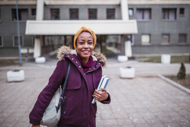 Portrait of African female student in front of the University campus stock photo