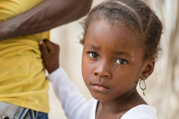 Portrait of African sad little girl stock photo