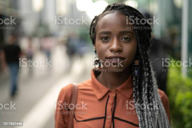 Portrait of african woman at street picture id1017932446?b=1&k=6&m=1017932446&s=612x612&h=2fjihobyxevnybox95d4j  vanimxnh1cn24qu ietk=