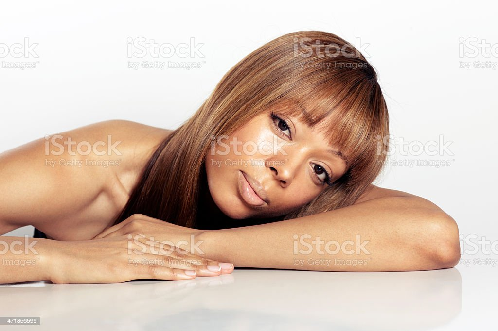 Portrait of african woman head resting on arms stock photo