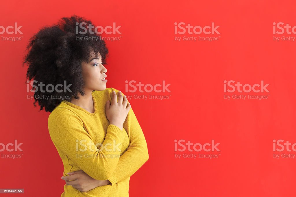 Portrait of african woman on red background stock photo