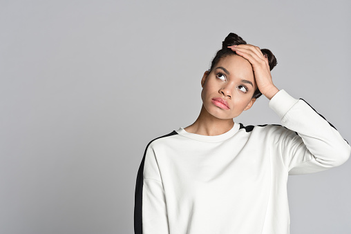Portrait Of Afro American Teenager Woman Looking Up Stock Photo - Download Image Now