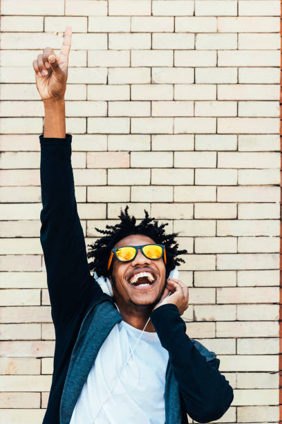 Portrait of afro handsome man listening music. stock photo