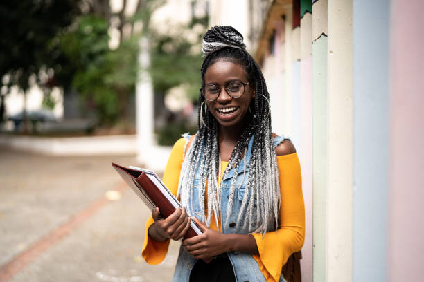 Portrait of Afro Student Looking at Camera nerd hairstyles for girls stock pictures, royalty-free photos & images