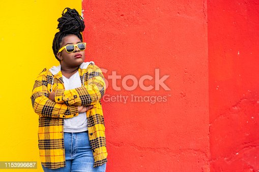 Portrait of afro woman on colorful background