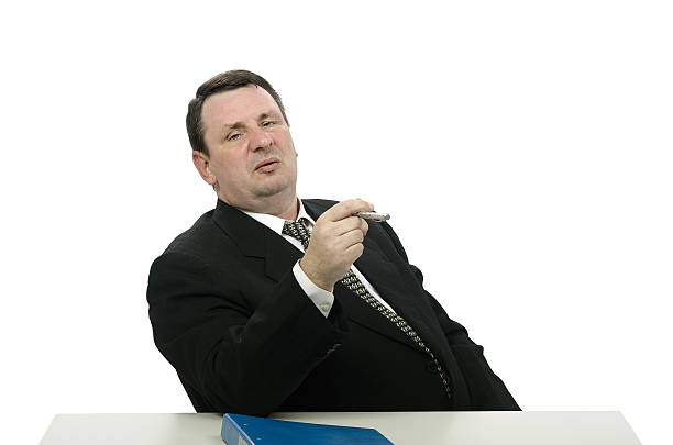 Portrait of aggressive interviewer Middle-aged man portraying aggressive arrogant interviewer on white background adversarial stock pictures, royalty-free photos & images