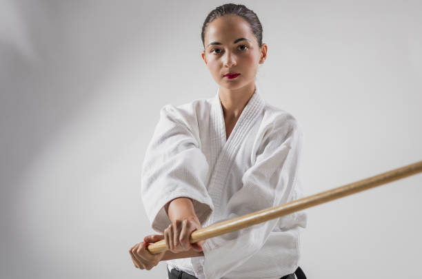 Portrait of Aikido Warrior Holding Bokken Sword stock photo