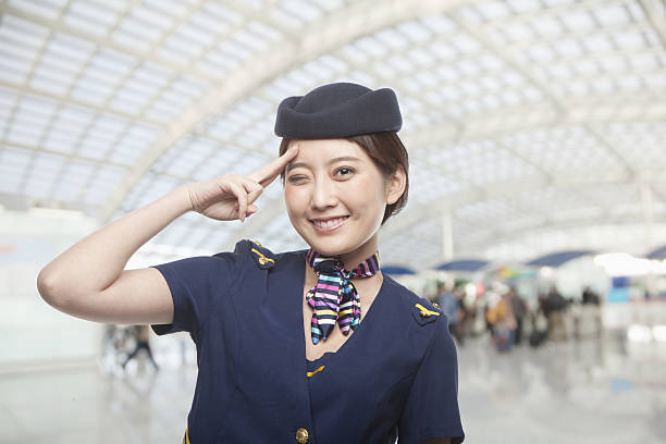 Portrait of Air Stewardess Winking Portrait of Air Stewardess Winking air stewardess stock pictures, royalty-free photos & images