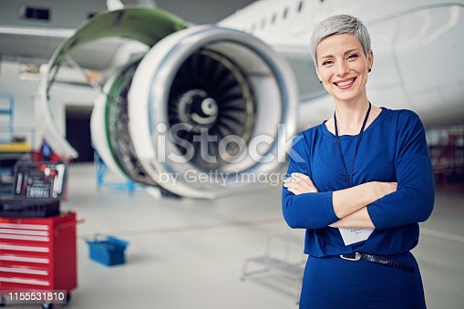 Portrait of airplane hangar manager
