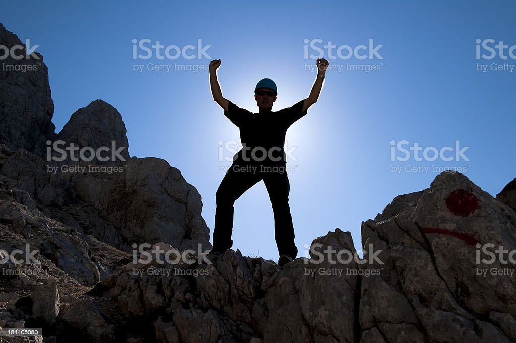 Portrait of alpinist against the sunlight royalty-free stock photo