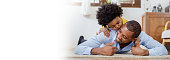 istock Portrait of american african father and son kissing laughing and bonding on living room floor. Daddy and his little boy spending leisure time at home. Single dad fun love family lifestyle father's day concept banner 1269862129