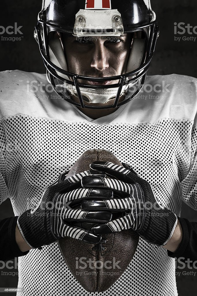 Portrait of american football player holding a ball stock photo