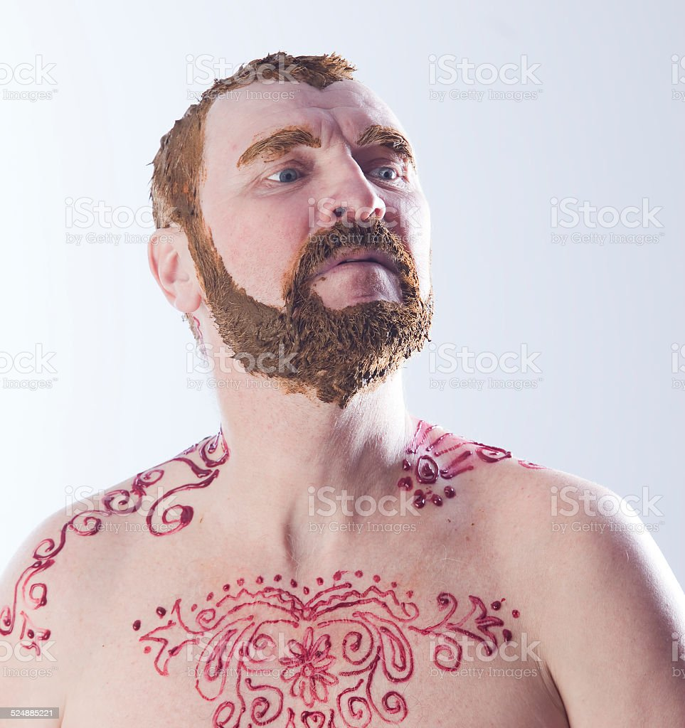 Portrait of an adult male in makeup stock photo
