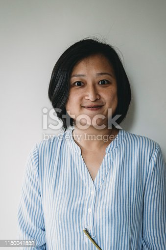 istock Portrait of an adult taiwanese woman looking at camera 1150041832