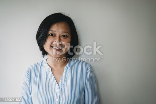 istock Portrait of an adult taiwanese woman looking at camera 1150041839
