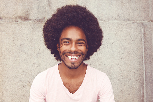 Portrait of an african american hipster man outdoors in vintage retro look