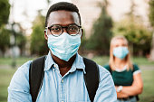 istock Portrait of an African American student wearing a face mask 1270079583