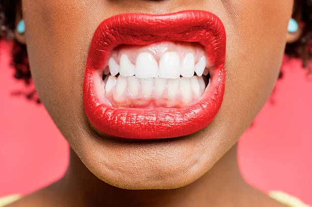 Portrait of an African American woman Detail shot of woman clenching teeth clenching teeth stock pictures, royalty-free photos & images