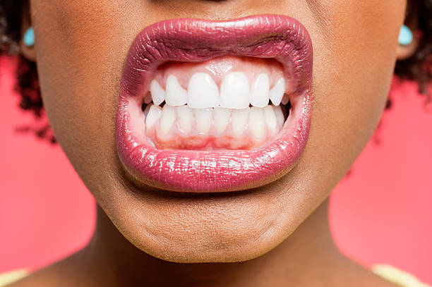 Portrait of an African American woman Cropped image of woman clenching teeth grimacing stock pictures, royalty-free photos & images