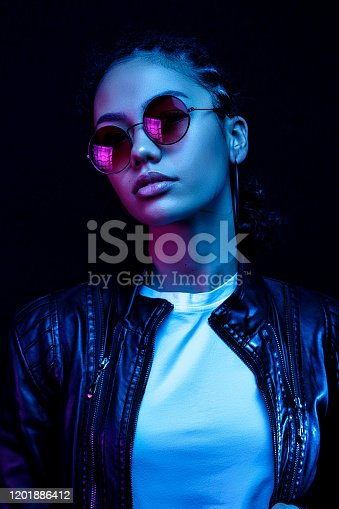 Fashion young african girl black woman wear stylish pink glasses looking at camera isolated on black studio background, horizontal banner for website design, portrait, copy space